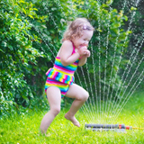 child_playing_in_water